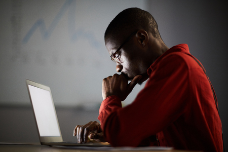 African Businessman Working in Dark