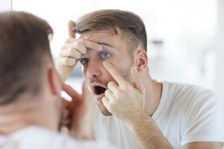 Man Checking Contact Lenses