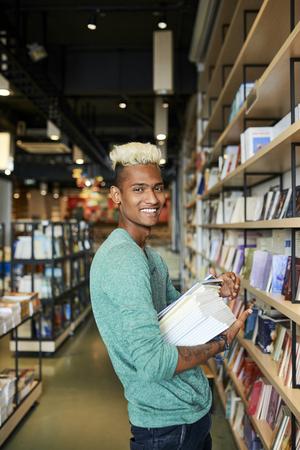 Happy bookstore employee in shop