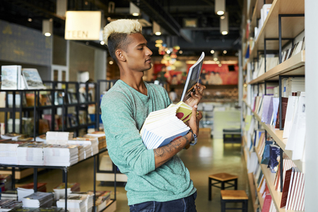 Bookstore manager doing inventory Stock Photo