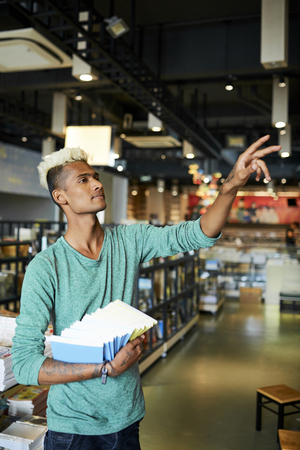 Taking textbooks in library Stock Photo