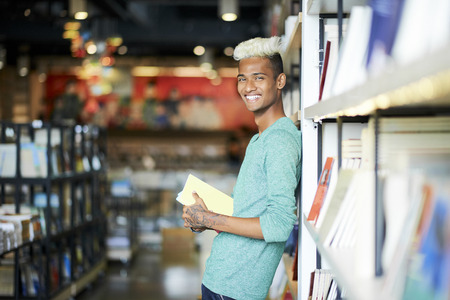 Excited black student visiting library Stock Photo