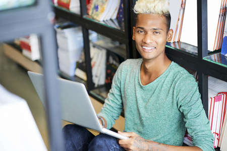 Modern black student studying scientific literature Stok Fotoğraf