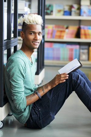 Smiling curious student in university library Stock Photo