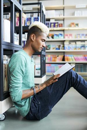 Black student reading interesting book