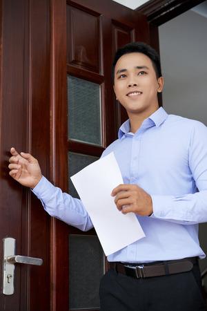 Man entering office