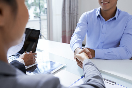 Handshake of applicant and employer 스톡 콘텐츠