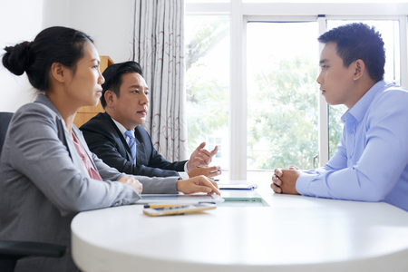 Coworkers interviewing applicant