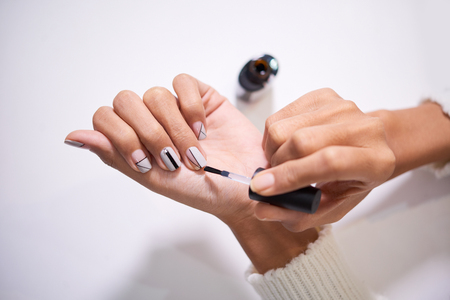 Woman applying nail polish