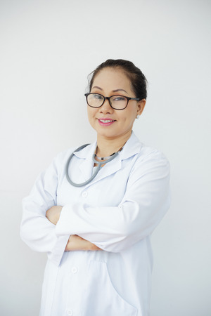 Portrait of confident experienced doctor