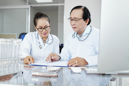 Doctors discussing medical history