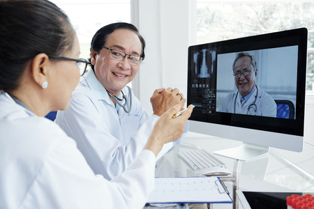 Medical workers having video conference Stock Photo