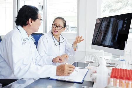 Doctors discussing case of pneumonia Stock Photo