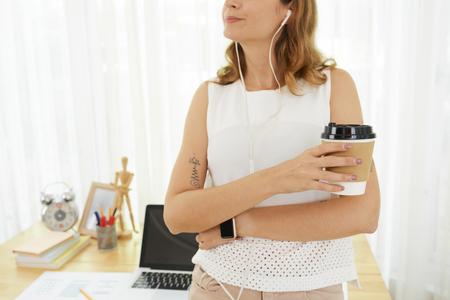 Female freelance drinking coffee Stock Photo