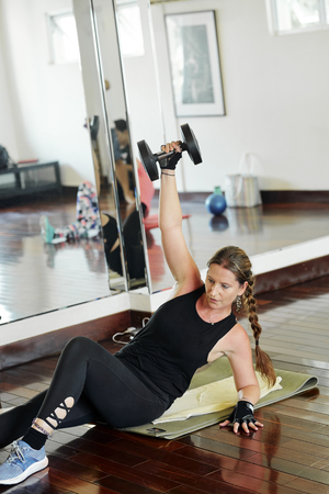 Strong woman exercing in gym