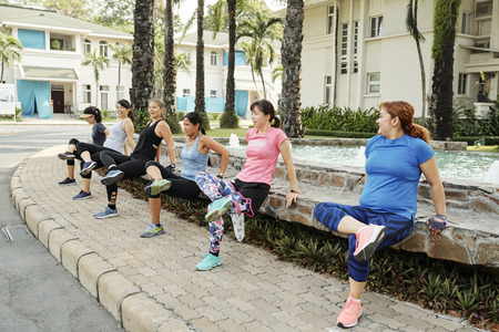 Group of women doing reverse press-ups Stock Photo