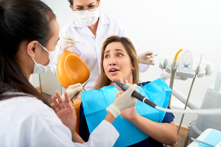 Panicking dentistry patient Stock Photo