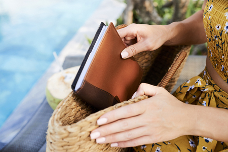 Woman taking journal out of bag