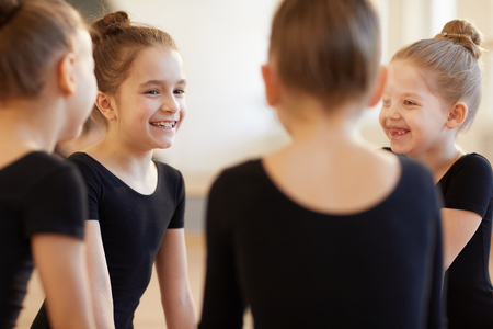 Girls Giggling in Dance Class