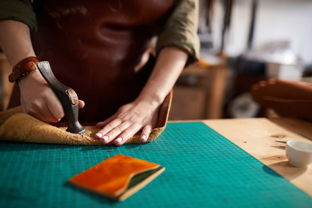 Woman Making Leather Wallet