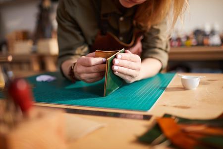 Unrecognizable Woman doing Leatherwork