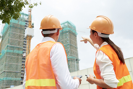 Business people observing the construction