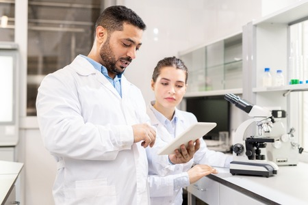 Examining test solution on tablet