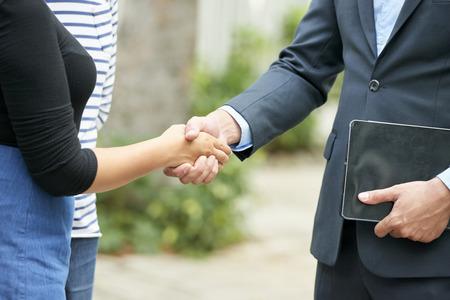 Business handshake outdoors