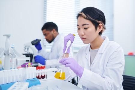 Lab technician testing sample
