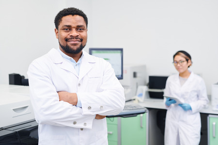 Content experienced African-American medical scientist Фото со стока