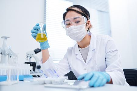 Lab technician processing specimen