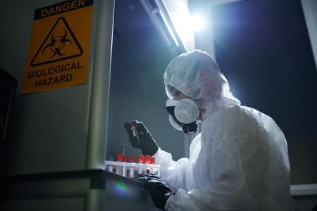 Microbiologist examining hazardous samples