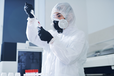 Concentrated healthcare scientist testing virus sample
