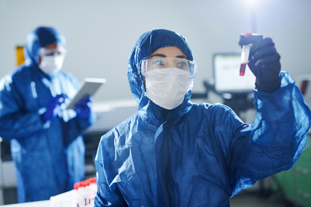Healthcare scientist working with dangerous sample Stock Photo