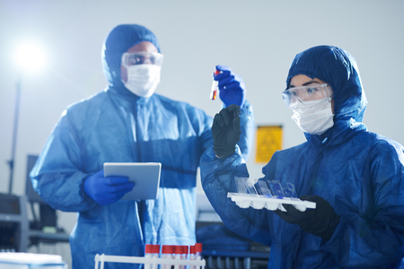Virologists doing blood tests Stock Photo - 125417436
