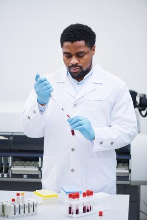 Medical specialist analyzing blood sample 版權商用圖片