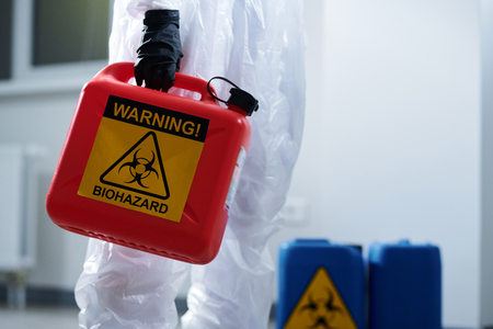 Carrying container with biohazard
