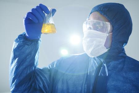 Examining urine sample in laboratory Stock Photo
