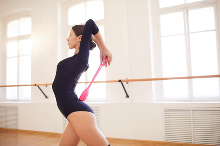 Artistic gymnast dancing with clubs