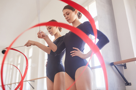 Practicing dance element with gymnastic ribbon Stock Photo