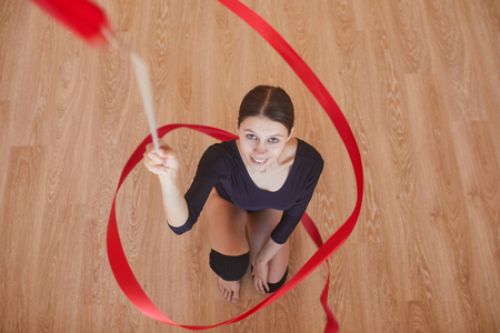 Ambitious rhythmic dancer with gymnastic ribbon Stock Photo