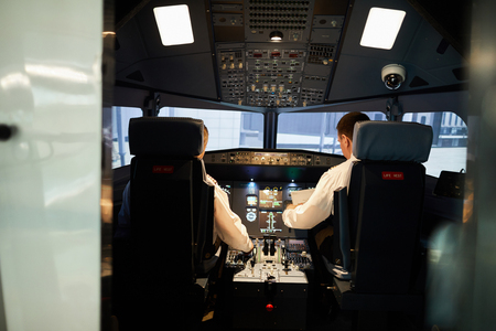 Pilots in airplane cockpit