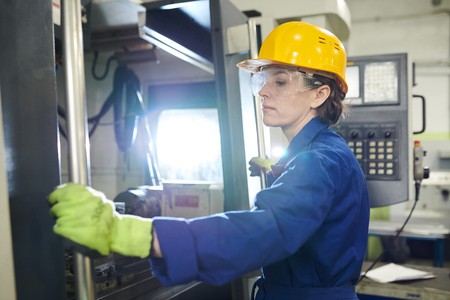 Woman Working at Plant Stock Photo