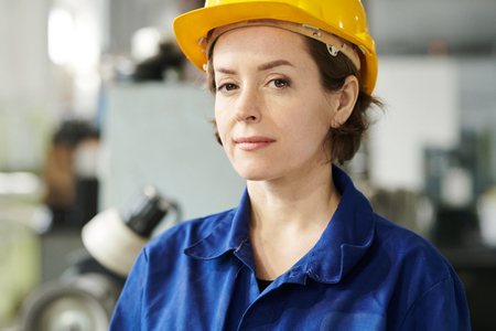 Smiling Female Worker Stock Photo