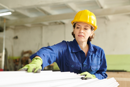Female Worker at Production Factory Stock Photo