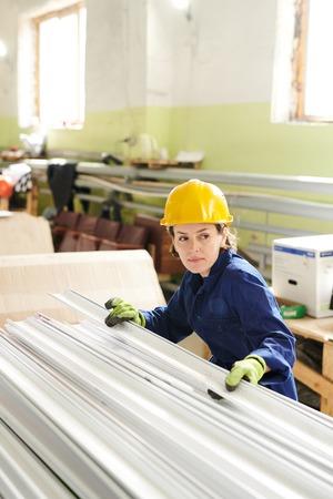 Female Worker Wearing Hardhat Stock Photo