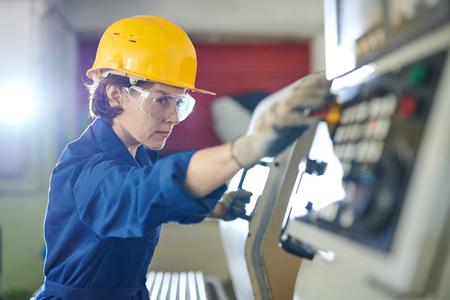 Woman Pushing STOP Button Stock Photo