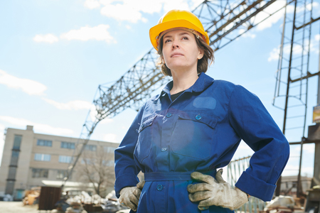 Confident Woman Posing at Construction Site Stock Photo
