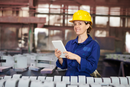 Smiling Woman Managing Production