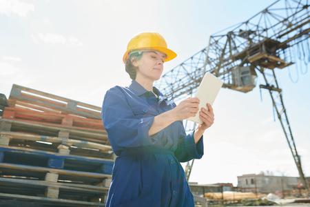 Female Worker Using Tablet in Sunlight